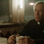 Reverend Alfred Kanpp (Patrick Gorman) sitting in a diner on Sleepy Hollows