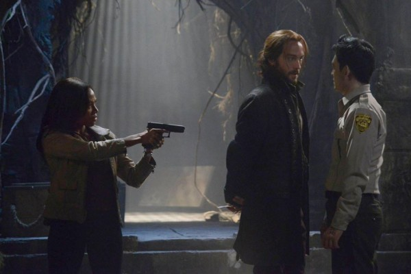 """Abbie Mills draws a gun on the undead Andy Brooks as Ichabod confronts him on the """"Midnight Ride"""" episode of Sleepy Hollow"""
