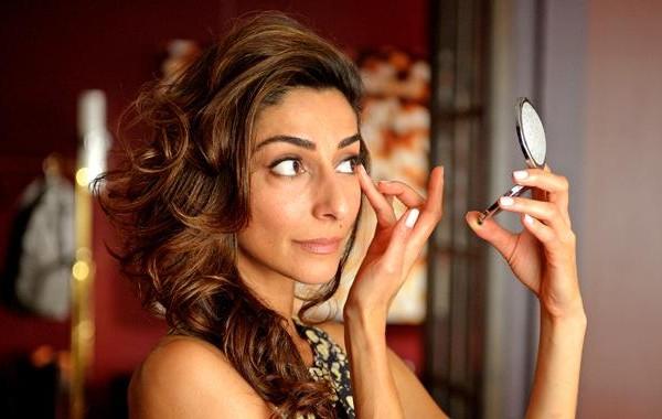 Delia checks her makeup